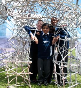 Three make students in wire mesh structure.