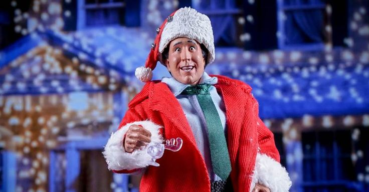 """National Lampoon's Christmas Vacation – """"Santa"""" Clark Griswold 8″ Scale Retro Style Figure. The figure portrays Chevy Chase's Clark Griswold as he appears near the end of the film, complete with Santa hat and coat. The figure also includes a Wally World mug and a replica of the Swimming Pool Clark wants to install."""