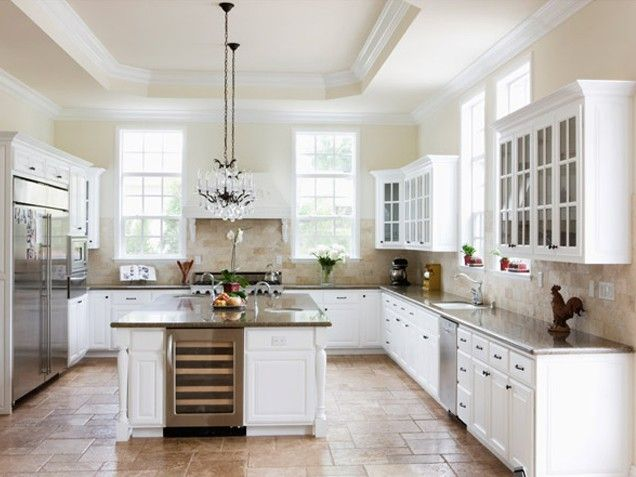 This clean, monochromatic white kitchen has touches of warm brown hues for a kitchen looks homey and put together -- #kitchen #white