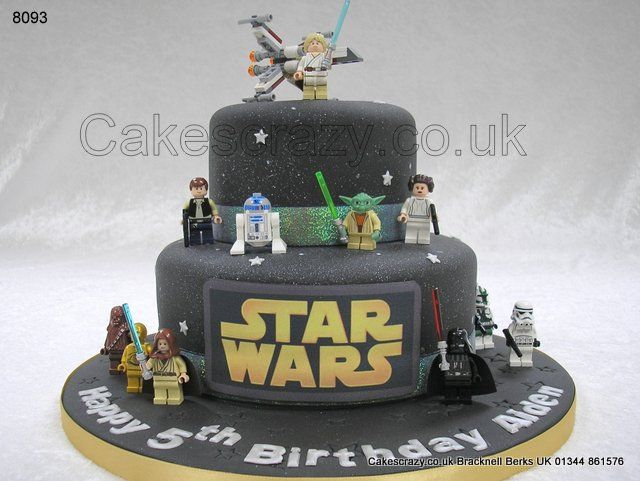 The Force is strong with this one... Star Wars themed two tier celebration birthday cake decorated in a black galactic finish with gold logo. Selection of Lego toy starwars characters strategically placed on and around the cake.    Supply your own characters.