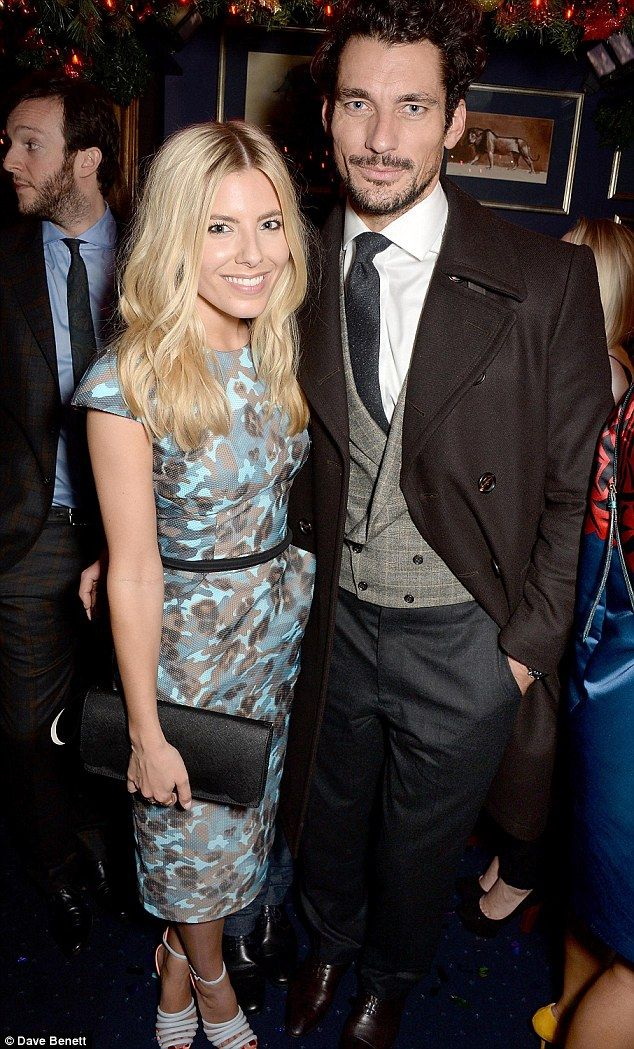 A good looking pair: Mollie King and David Gandy made an appearance at the Sunday Times Style Xmas party in London on Tuesday evening