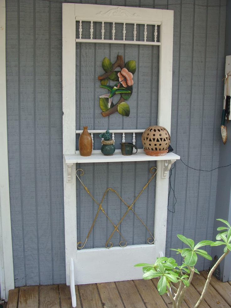 old screen door with shelf