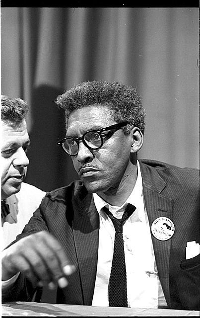 [Bayard Rustin at news briefing on the Civil Rights March on Washington in the Statler Hotel, half-length portrait, seated at table]. Photo by Warren K. Leffler, August 27, 1963.  U.S. News & World Report Magazine Photograph Collection, Library of Congress Prints and Photographs Division. Bayard Rustin Papers Collection at the Library of Congress: http://hdl.loc.gov/loc.mss/eadmss.ms996004