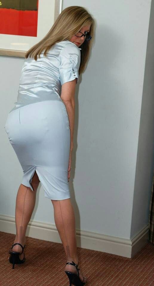 visible garter bumps tight blue satin pencil skirt