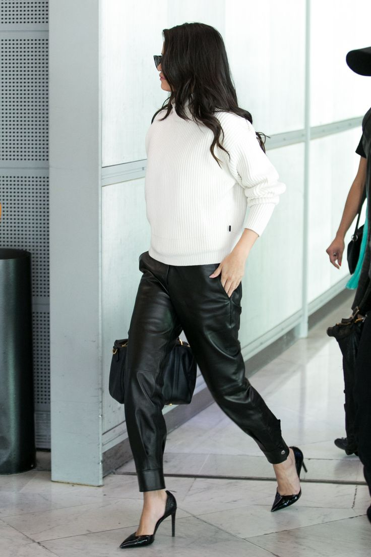 Selena Gomez knows how to rock a leather pant! To get her look, roll the sleeves on a sweatshirt and pair with leather jogger pants and a mid-heel stiletto pump.