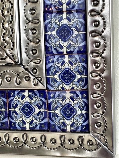 840mm high x 635mm wide.  A gorgeous hand punched tin mirror with hand made ceramic talavera tiles from Mexico. Very ornate and can be hung either landscape or portrait.  Not available to be couriered sorry, due to fragile mirror glass.