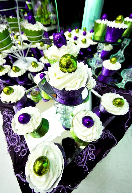 """Home made cupcakes with """"Bedazzle my Bon Bon's"""" as toppers and matching cupcake wrappers."""