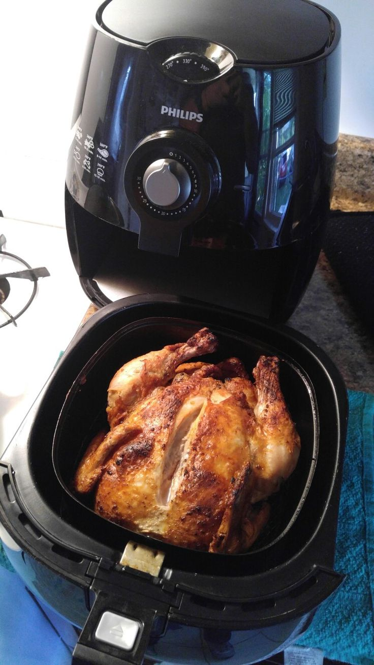cook young chicken in an air fyer  I did this for the first time and it was super juicy and crispy!! its a must try.   preheat air fryer for about 2 mins @ 350 degrees.    -Add seasoning around the whole chicken ( I used salt pepper and garlic powder)   -then air fried the chicken for 30min on 350 degrees -turned the chicken over and air fry for another 30 min.   - I then cut into the chicken to make sure there was no pink chicken - cut it and serve