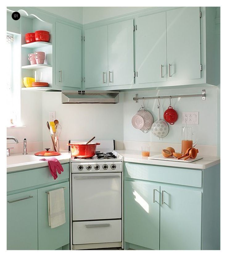 LOVE the colors in this vintage kitchen. Red + aqua = awesome
