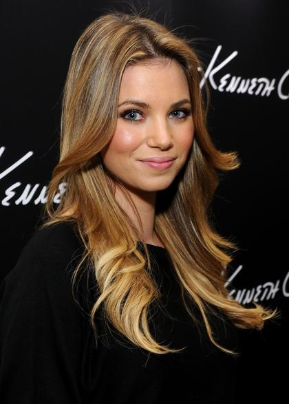Actress Amber Lancaster sported '70s-style flips at a boutique opening in Santa Monica, Calif.