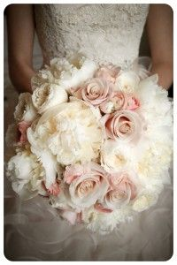 A romantic bouquet of white peonies, white garden roses, mother of pearl roses and blush pink ranuculas.