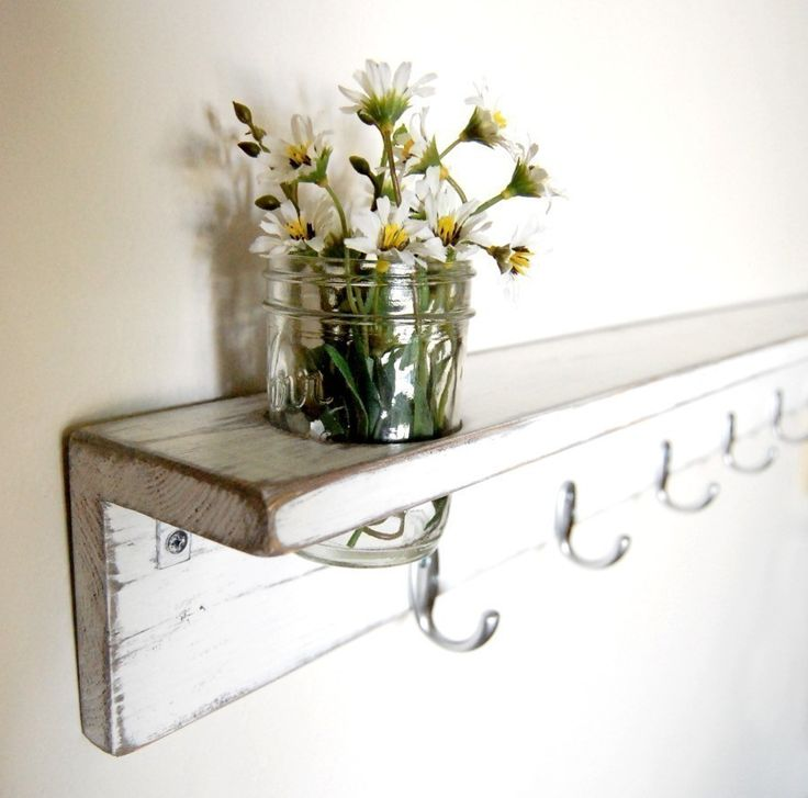 Make your own rustic shelf with hooks. A great look for the hallway or kitchen.