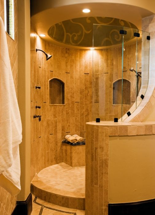 Rounded open shower but with an addition of a waterfall shower head