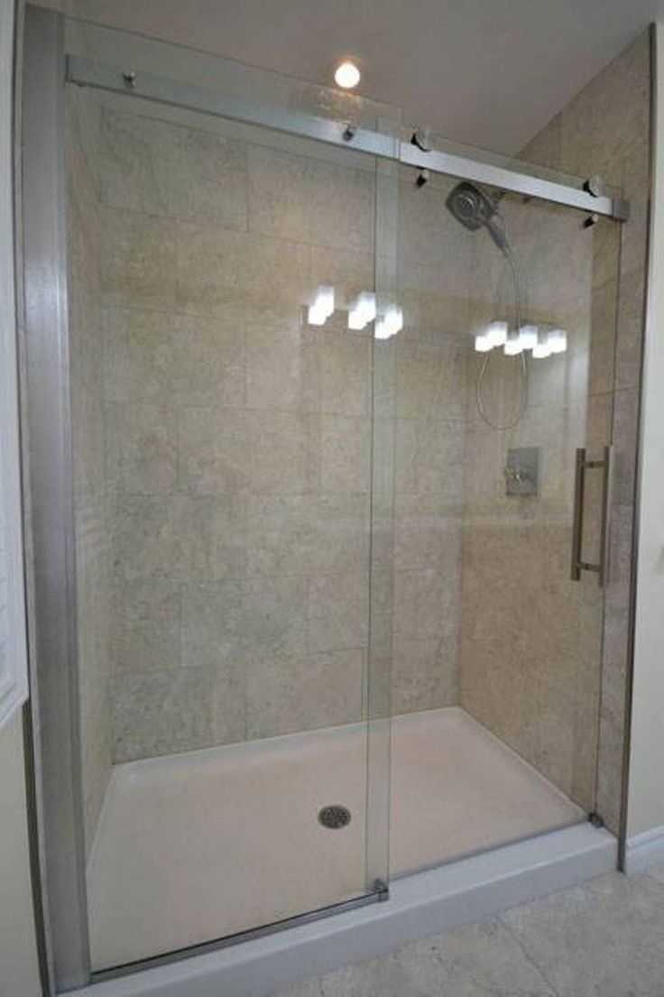 shower pan with sliding glass door in bathroom