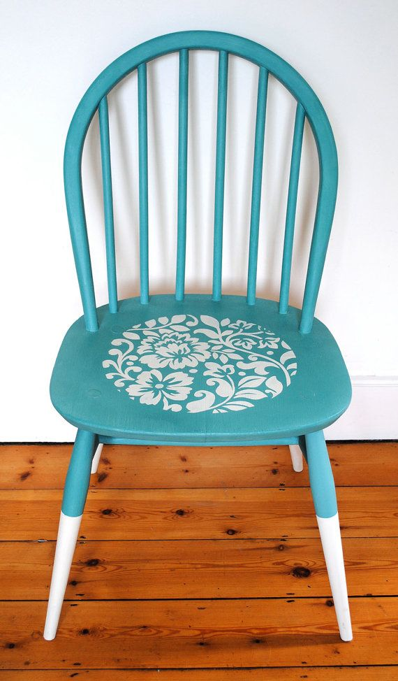 An upcycled Danish wooden chair with an Ercol sticker on the back.  It has been painted and stencilled using the finest quality Annie Sloan chalk