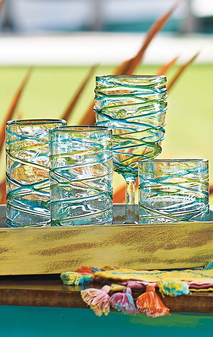 Give new meaning to swirling your drink. Available in Sunset or Ocean inspired palettes, this Frontgate exclusive drinkware pays homage to the beauty of the tropics.    Margaritaville by Frontgate