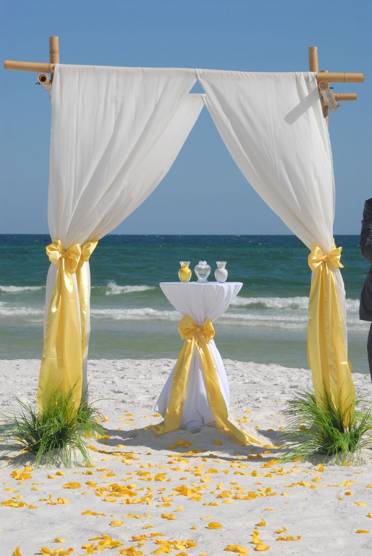 Barefoot bamboo beach wedding arbor with unity sand table