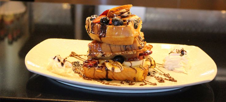 I could never make waffles that look this good at my house. They look like the perfect combination of fluffy and crispy. I wonder if it is possible to get waffles like this delivered to my house. They look like they would be a great late night snack.