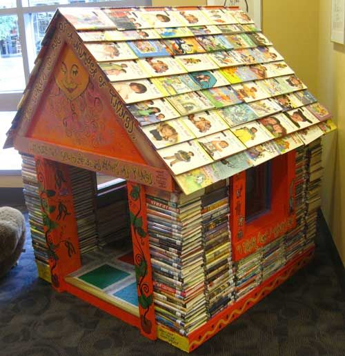 Miniature house made out of stacked books, with books for shingles on the roofChild Room, Plays House, Iowa Cities, Playhouses, Cities Public, Reading Nooks, Book House, Public Libraries, Children Book