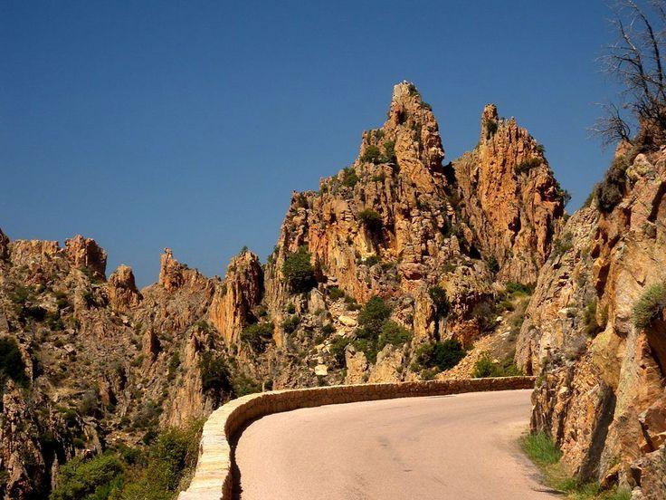 Curved road between stone towers of Calanques de Piana - Corsica