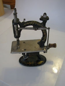 antique sewing machine hand crank, probably for a child. This machine produced a very nice locked running stitch.