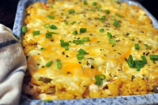 yellow rice casserole with layers of vegetables, chicken, olives and cheese. BUT~ what makes it creamy-melty-yummy is the cream and (yes!) mayonnaise that goes in it. Even mayo haters love it. (Because they don't know it's mayo)