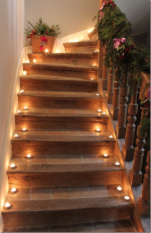 Hellooooo, magically lit stairway! Romantic candlelight along a walkway or stairs is really lovely for party guests. Use LED tea light candles for safety: http://www.flashingblinkylights.com/light-up-products/flickering-led-candles.html