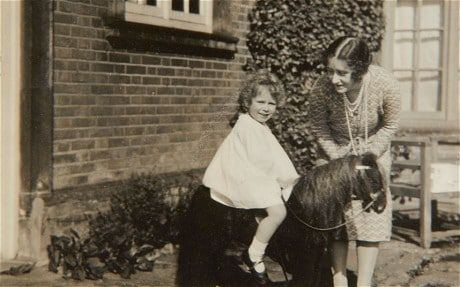 Her passion for horses has been with her since childhood, when she kept a collection of 30 or more toy ponies on wheels on the landing at her parents' house in London, 145 Piccadilly. Unpublished childhood photos show the Queen's early love of horses - Telegraph