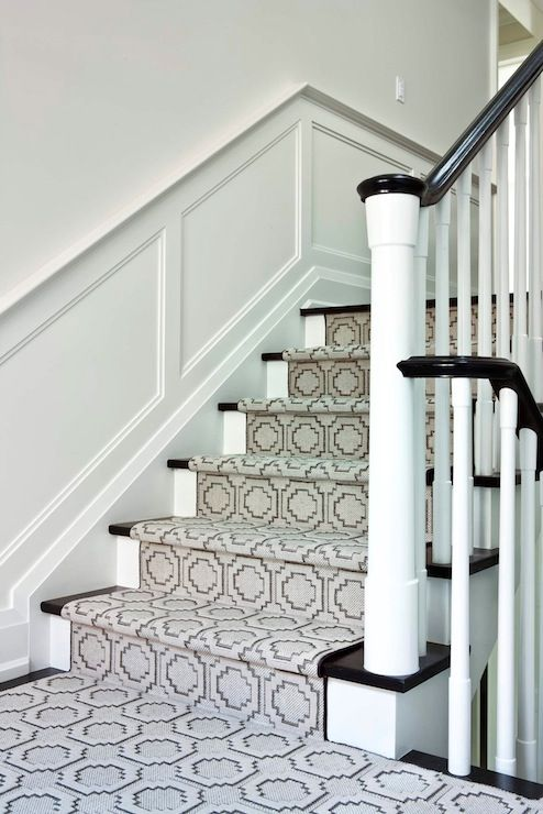 Jennifer Worts Design: Second floor landing with wainscoted walls and gray geometric pattern stair runner. ...