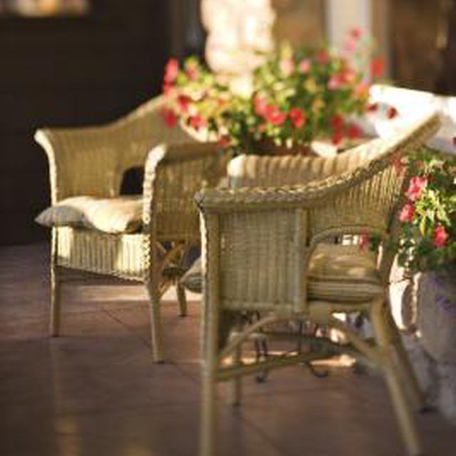 Repainting an old wicker chair can give it new life.