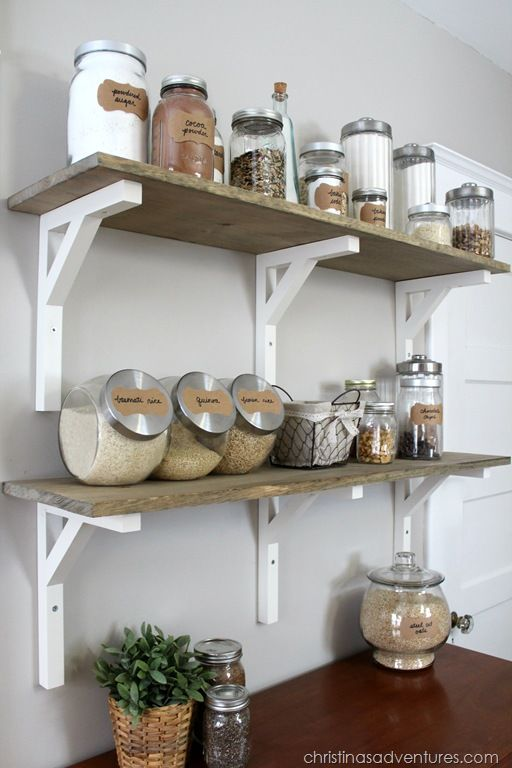 Open shelving pantry: wood shelves + glass containers make this pantry beautiful. A dresser underneath adds character & hides items not displayed.