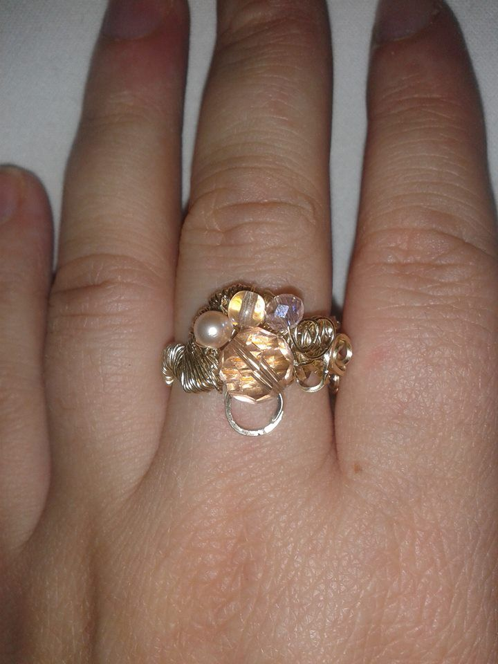Another wire wrapped ring. 14k gold rolled with some swarovski beads.