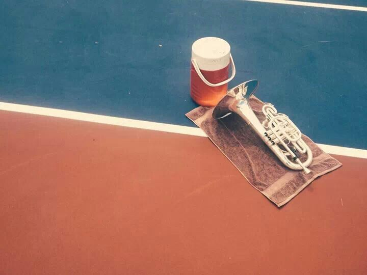 A mellophone at a rehearsal, the towel has turned pinkish from the relentless sun.