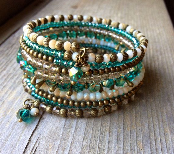 This 9 coil bracelet is made with brass memory wire - will adjust to the size of…