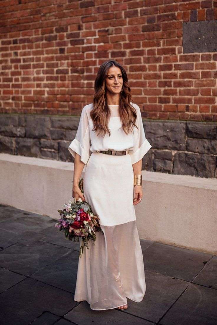 modern bride in minimal wedding dress and chunky gold belt