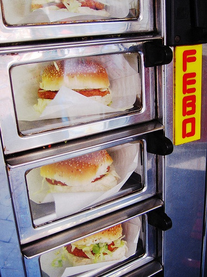 Febo is a Dutch snack bar chain that offers its fast food in a vending machine. We call that: 'uit de muur eten' (eating from the wall).