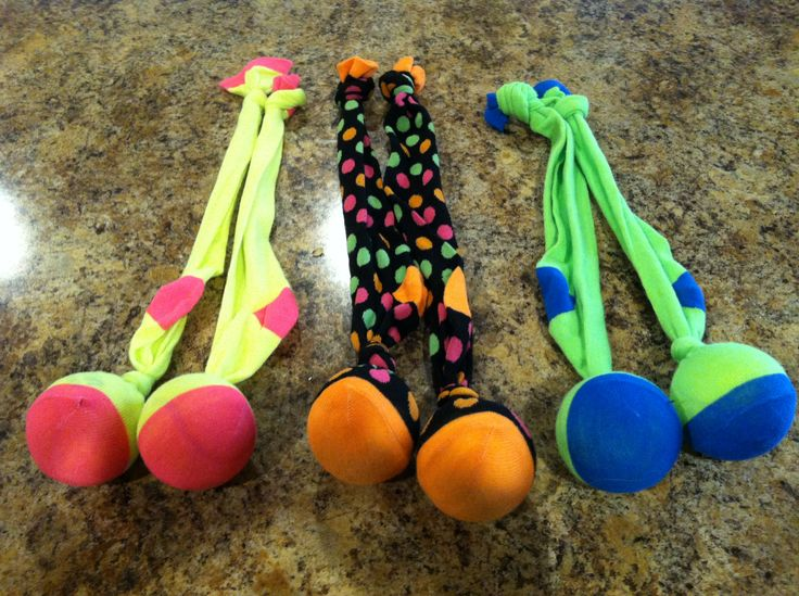 Our home made practice Poi. Cheap knee high socks with tennis balls. Two pair are weighted with coins on the inside--they do swing better.  I weighed them on a food scale to make sure the weight was even. Easy to make a cut in the ball...they swallow up the coins and regain their shape after. We found that by knotting the tops we could slip our middle fingers through so that we could rotate our hands and not have to hold on. The seven year old learned how to spin and cross fairly easy!