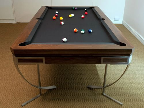 Looking for a dual-purpose pool or snooker dining table? Look no other than Sir William Bentley Billiards. These tables are handmade from solid American black walnut and highly polished steel. Browse our gallery section to view some tables handcrafted by our craftsmen.