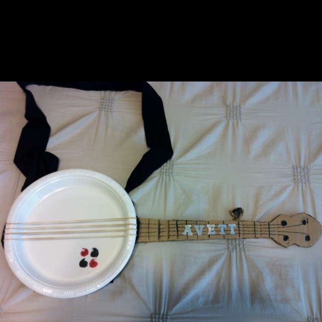 "Banjo for my son's 3rd grade musical program, ""Destination America"".  He wanted to go as Scott Avett.  =raised him right. Paper plate, rubberbands, cardboard...voila!"