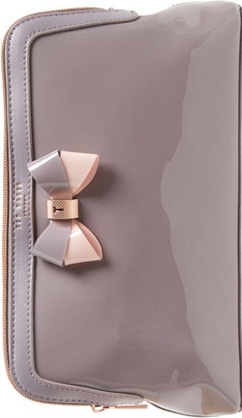 •Website: http://www.cuteandstylishbags.com/portfolio/ted-baker-london-mid-purple-large-bow-madlynn-cosmetics-case/ •Bag: Ted Baker London Mid Purple 'Large Bow – Madlynn' Cosmetics Case