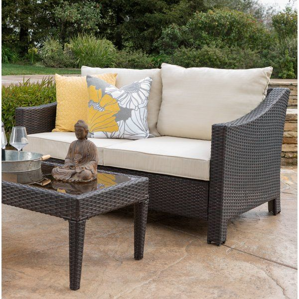 This wicker love seat and table are a great addition to any patio. The water resistant cushions in conjunction with the wicker make both the love seat and table ideal for an outdoor setting (good to stay out all summer long.) The slight curve of the arms adds the perfect amount of flair, giving you a stylish and comfortable love seat and table for your patio.