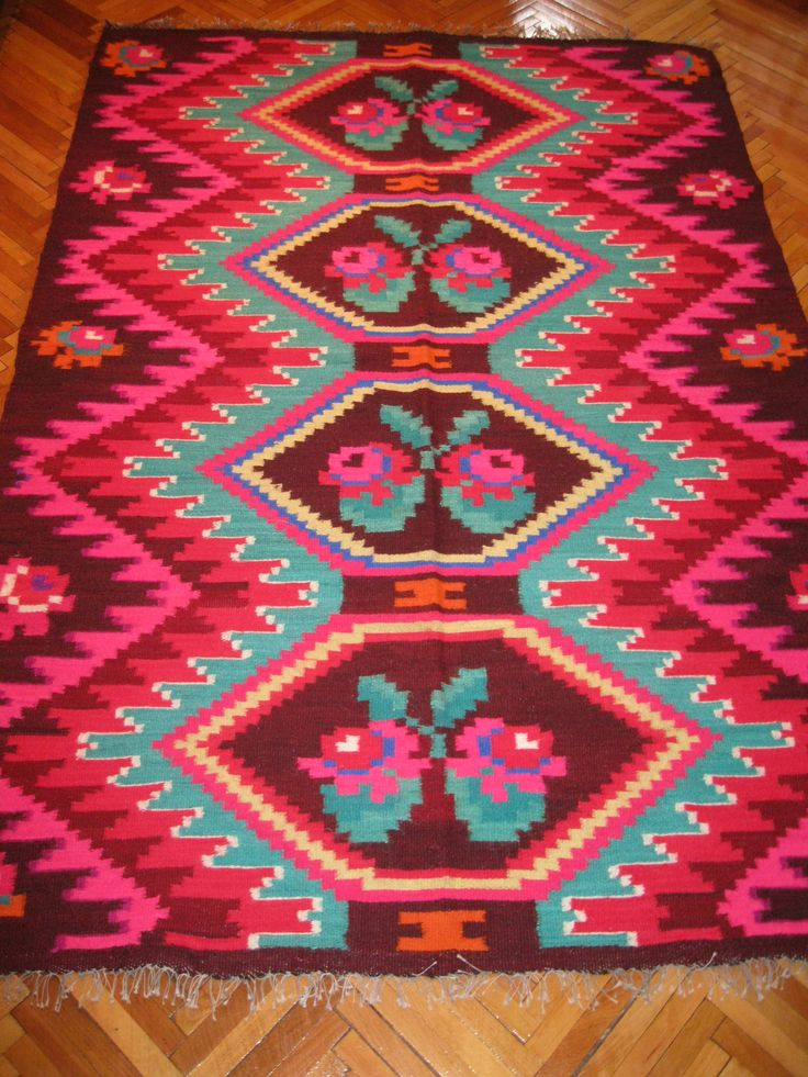 Beautiful antique traditional Romanian woven wool carpet / rug with floral pattern. Hand woven in Northern Transylvania / Maramures county 50 - 70 years ago. Hand woven with wool on cotton thread foundation.  Available at www.greatblouses.com
