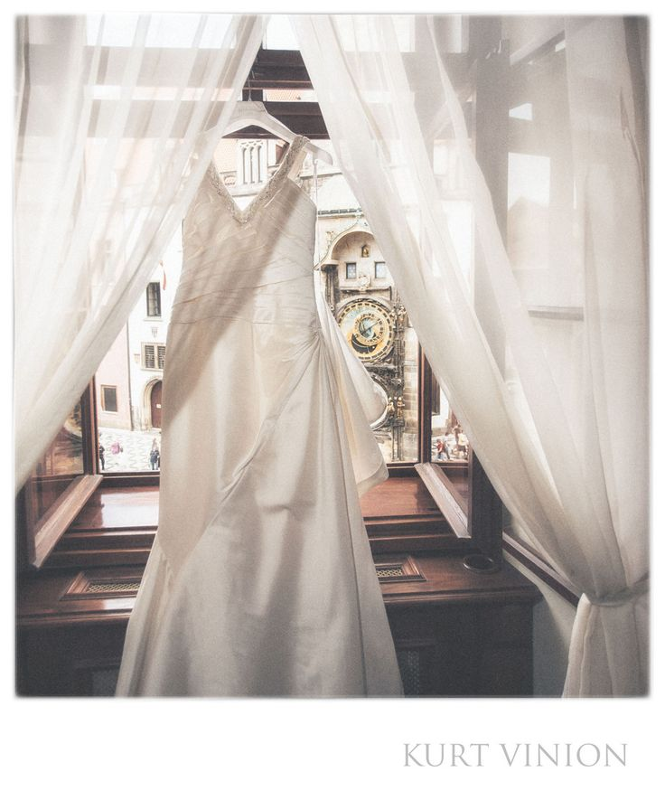 London wedding & Prague pre wedding photographer - wedding dress Astronomical Clock: the wedding dress as it overlooks the Astronomical Clock in Prague's Old Town Square. Location: Old Town Square Prague.