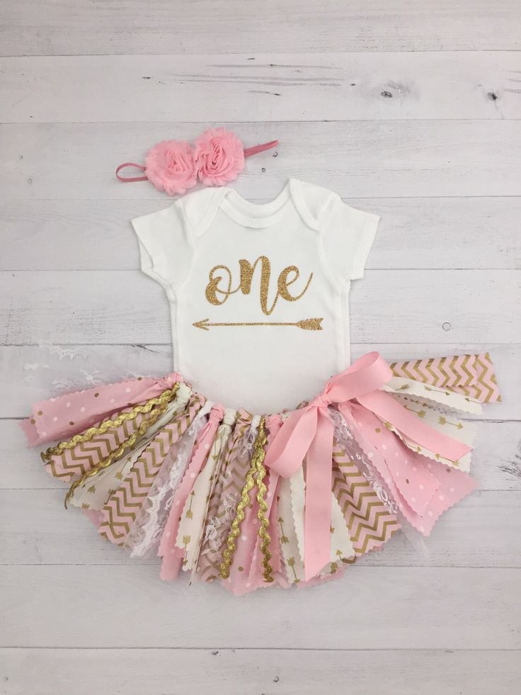 Pink and Gold Arrow First Birthday Outfit with Headband, Arrow Bodysuit and Tutu/Pink and Gold Fabric Tutu/Baby Girl Bodysuit/Shirt with Age by MeadowsMarvels on Etsy https://www.etsy.com/listing/470602199/pink-and-gold-arrow-first-birthday