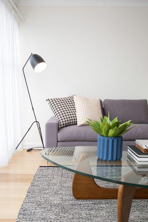 Retro, art deco formal sitting area, polished floorboards, noguchi coffee table, grey sofa, black floor lamp