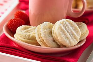 Vanilla Sandwhich Cookies- These bite-sized treats sandwiched together with a creamy vanilla filling are melt-in-your-mouth good. If only every moment could be this delicious!
