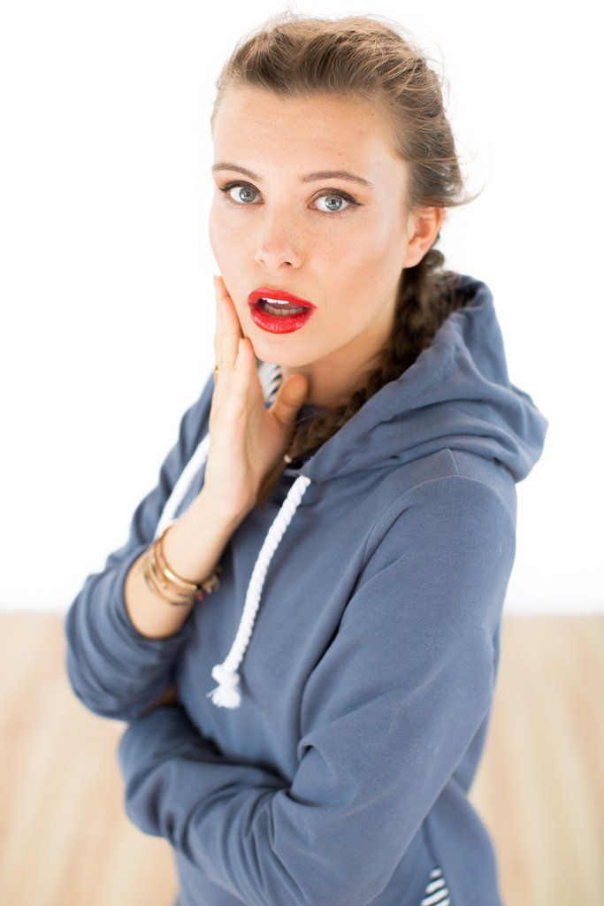 Hoodie SoCute Blue.We love this cosy hoodie, crafted from a blue-gray colored sweatshirt material with a soft, velvety feel. The front of the hood crosses over and half is lined with a blue and white striped fabric and half with a blue and white polka dot. The SoCute hoodie is decorated with a large drawstring and has kangaroo pockets to keep your hands toasty warm.
