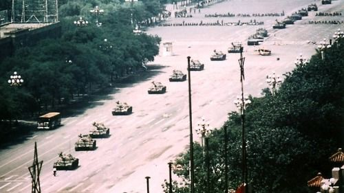 An unidentified person stops a line of Chinese tanks, Tienanmen Square, Beijing, 1989