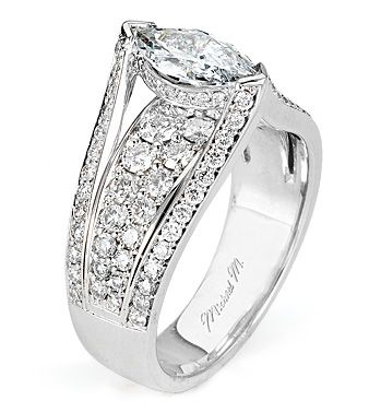 From Michael M. Collection This handcrafted platinum Engagement Ring features a distinctive marquis-cut center stone. Graduating pave-set diamonds arch along the shoulders and decoratethe carriage of the ring. Also available in 18k white, yellow and rose gold.