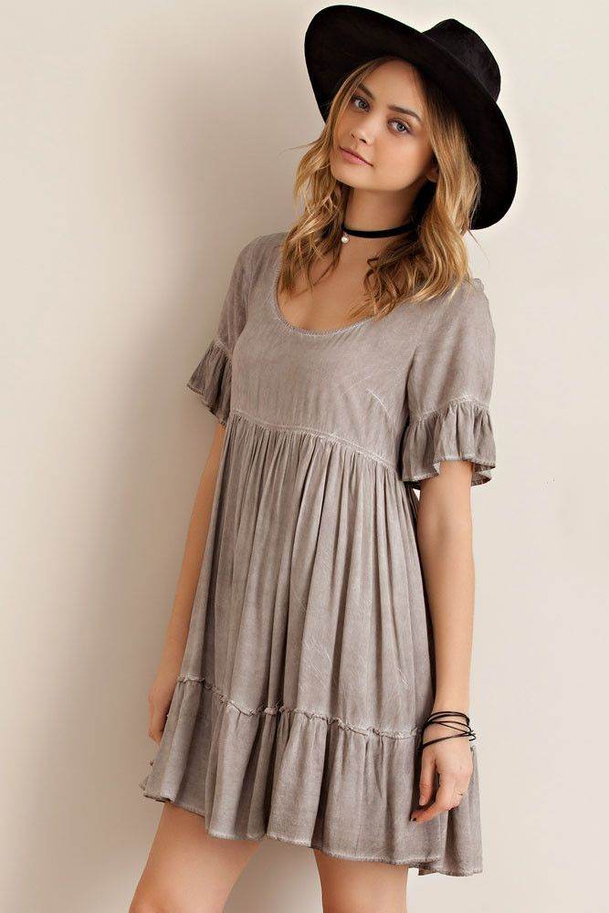- Mocha acid wash short sleeve baby doll dress with arm and bottom hem ruffle - Featuring back tie with key hole opening and it is full lined - Non sheer, woven and light weight rayon material - Oh so